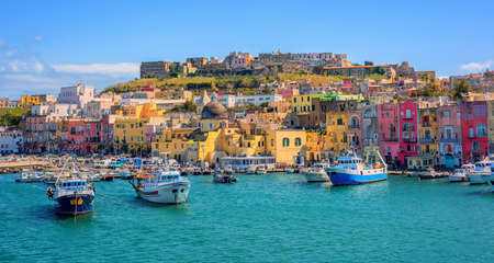 Colorful houses and boats in the port of Procida town, island of Procida, Gulf of Naples, Italy