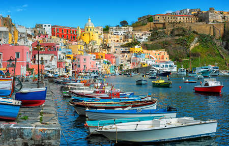 Colorful houses in port of Marina di Corricella, the oldest fishing village of Procida island, Naples, Italy
