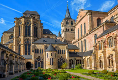 Historical romanesque and gothic style St Peter Cathedral in Trier, Germany, view from the cloister yard