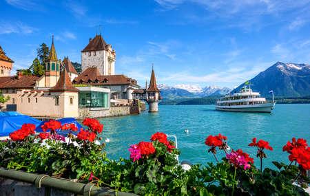 Oberhofen castle on Lake Thun in the Alps mountains, Canton Bern, Switzerland