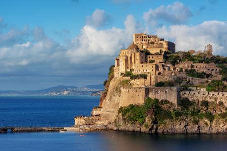 The Aragonese castle, the main historical landmark of Ischia island, Naples, Italy, in sunset light