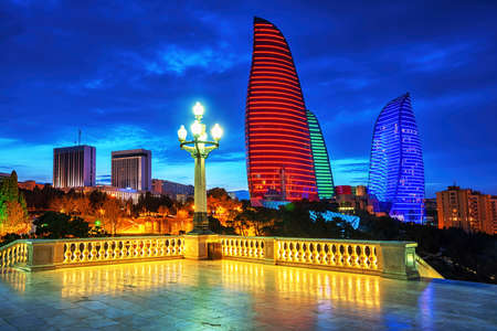 Baku, capital city of Azerbaijan, night skyline with Flame Towers building illuminated in Azerbaijan national flag colors
