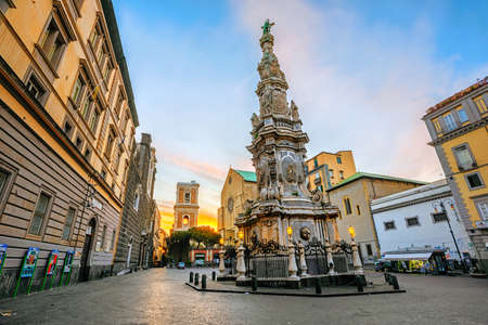 Naples, Italy - 19 April 2019: Gesu Nuovo square in historical old town center of Naples with Guglia dellImmacolata obelisk Santa Chiara church is an important example of baroque architecture 新聞圖片