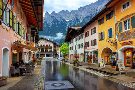 Mittenwald, Germany - 11 July 2019: Colorful painted houses in the Old town of Mittenwald, a popular tourist destination in Alps mountains, Bavaria