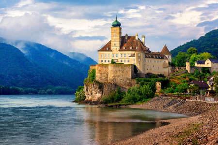 The medieval Schonbuhel castle, built on a rock on Danube river is a main historical landmark and popular tourist attraction in Wachau valley 新聞圖片
