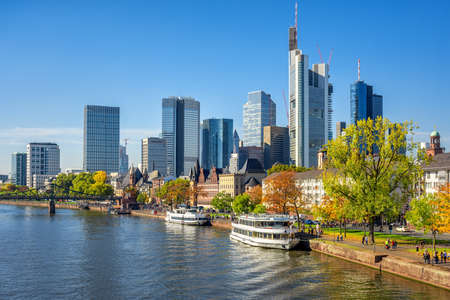 Frankfurt am Main, Germany, view of the modern financial district skyline and historical Main river riverside with cruise boats Editorial