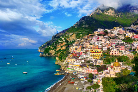 Positano, a town on Amalfi coast, Naples, Italy, dramatically set on a steep cliff between Mediterranean sea and mountains, is a famous travel destination and tourist resort in Italy