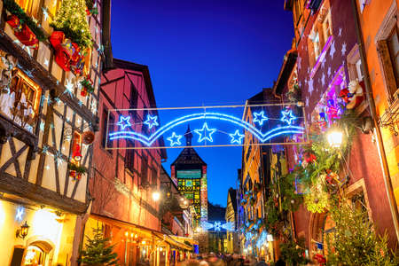 Festive Christmas illumination in the historical Old town of Riquewihr, Alsace, France