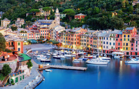Portofino, Italy, a picturesque fishing village with colorful houses and a small harbor on italian Riviera near Genoa city, is a popular tourist destination