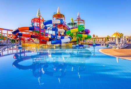 A big colorful inline tube water slide in a pool