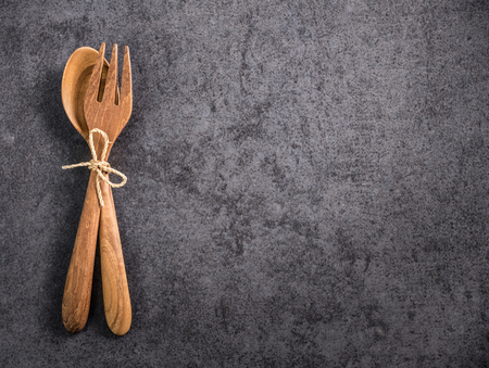 Space wood spoon and fork with on old marble Stock Photo