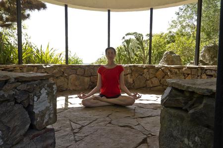 vriksasana: Yoga. Woman practicing yoga in nature, summer house.