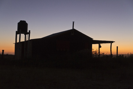 ranch: Ranch house at sunset Foto de archivo