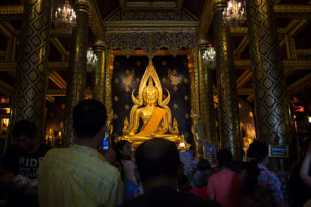 Phrae, Thailand - April 13, 2014: People are coming to paying respect to the Buddha at Wat Phrathatchohae on Songkran\'s day, Phrae, Thailand