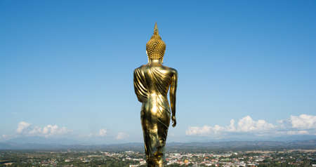 Buddha standing on a mountain Wat Phra That Khao Noi, Nan Province, Thailand photo