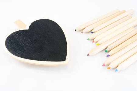 The frame as a heart with color pencil on white background