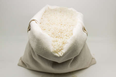 sandy brown: Burlap sack of rice Stock Photo