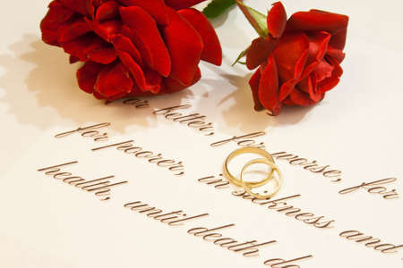 Wedding rings, vows and roses photo