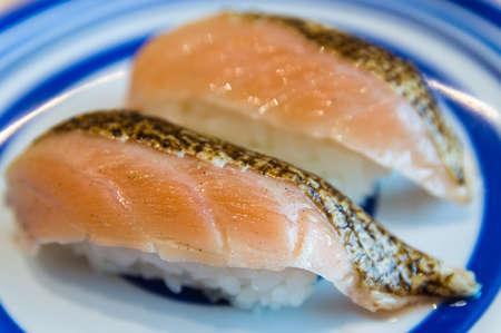 Two pieces of salmon nigiri photo