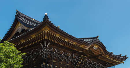gold top: Typical japanese buddhist roof ornamented in gold  Top of a temple in Narita  Shinshoji Temple  Tokyo