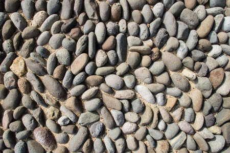 Smooth river stone background  photo