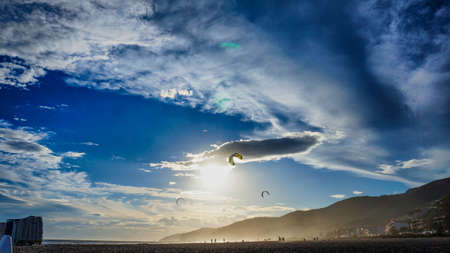 dynamic background: Kitesurfers against dynamic background. Stock Photo