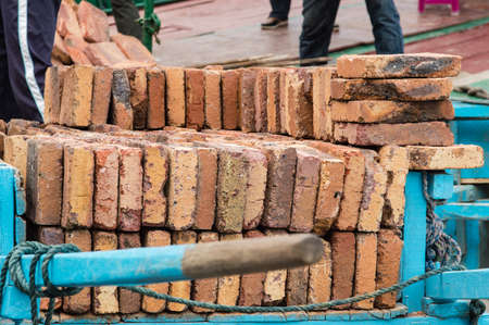 stocked: Close up of a Blue wooden dray stocked with bricks in gulangyu island. Stock Photo
