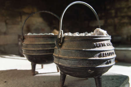 A cast iron pot is used for traditional cooking on an open fire in South Africa photo