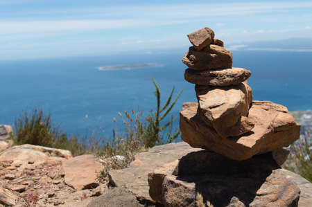 robben island: Stack of rocks with in the background Robben Island, Cape Town South Africa