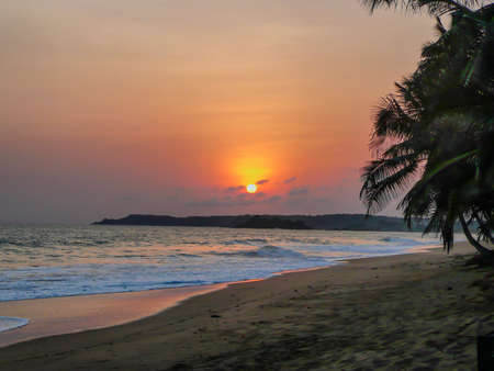 away from it all: Sunset at Remote Tropical Beach in Ghana, Africa Stock Photo