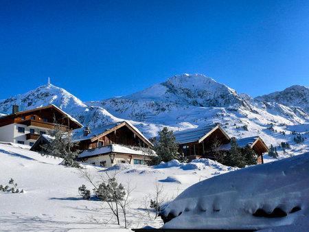 Chalets in Austrian Ski Resort. Typical housing in Austria Alps region.