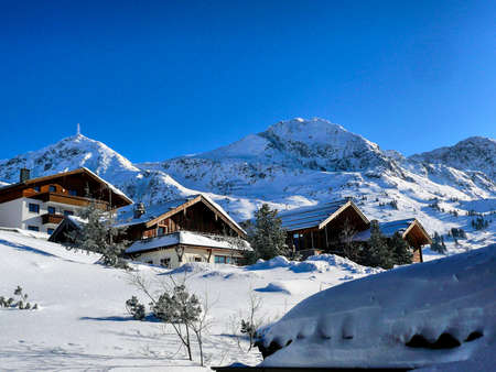 snowed: Chalets in Austrian Ski Resort. Typical housing in Austria Alps region.