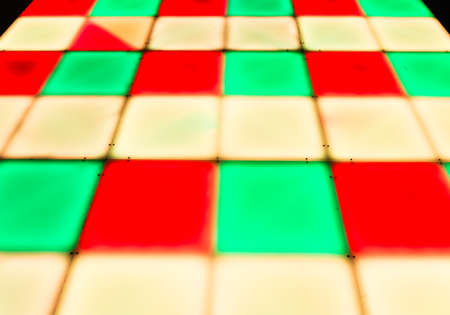 colorful square shape lighting of disco dance floor photo