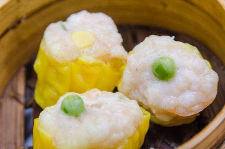 Shrimp dumplings in a bamboo steamer