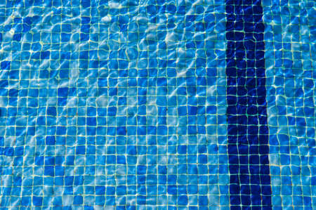 Blue tiles in a swimmig pool. photo