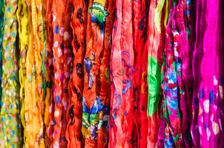 Colorful fabrics sold at an open market photo