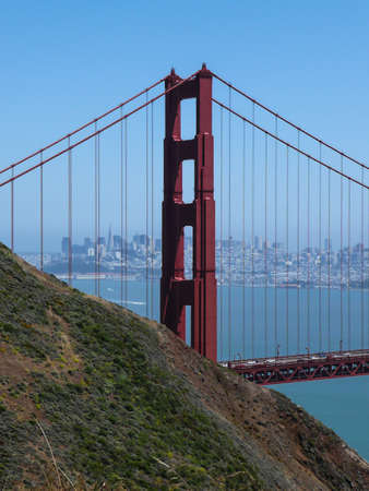 View of the Golden Gate Bridge with in the background the city of San Fransisco, California photo