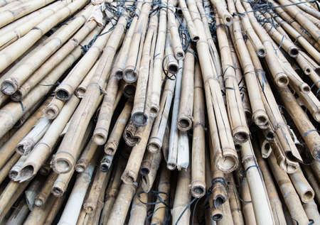 home addition: Close up of a pile of bamboo that are still being used in Hong Kong to build large scaffolds during building maintenance
