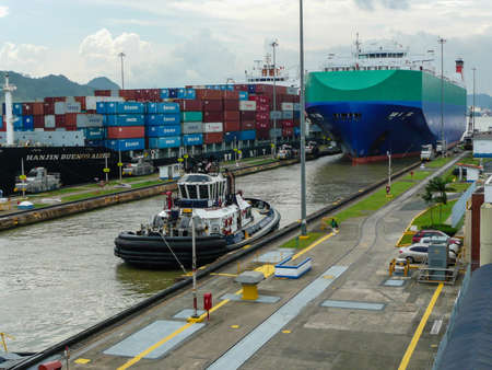 Two large ships wait to transit the Miraflores locks in the Panama Canal, just outside Panama City.