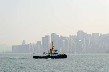 major ocean: Tugboat sails near Victoria Harbour, Hong Kong Stock Photo