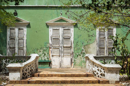 Decay of a beautiful colonial style house in Willemstad, Curacao.
