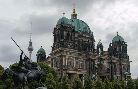 The Berlin cathedral and Fernsehturn television tower stand side by side as respected icons of the city.