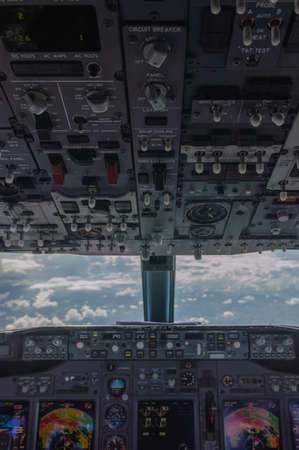 plane cockpit and cloudy sky photo