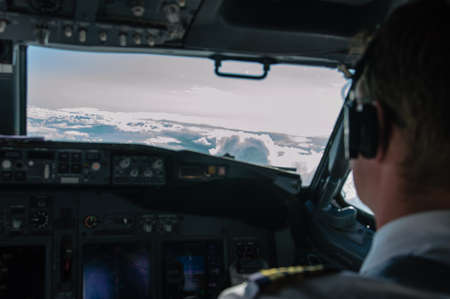 sop: cockpit view of an airplane with a pilot