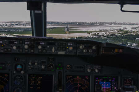 sop: cockpit view of an airliner about to land on final approach Stock Photo
