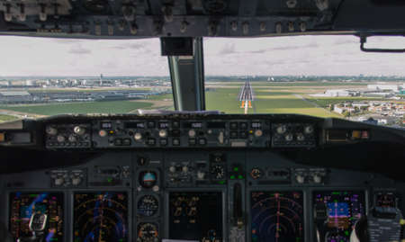 atc: cockpit view of an airliner about to land on final approach Stock Photo