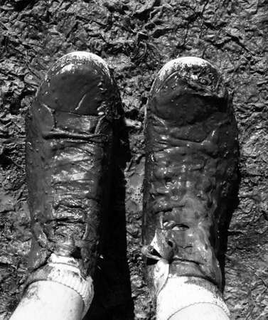 muddy shoes in the tideland at the seashore photo
