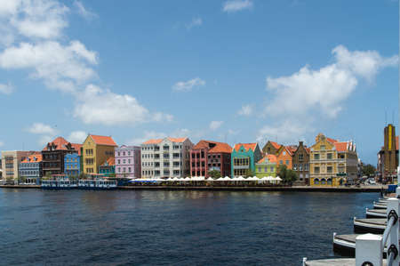The coloured houses of Willemstad, Curaçao in the Netherlands Antilles. The famous Queen Emma pontoon bridge in the foreground. photo