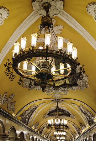Ornate ceiling and magnificent chandeliers at the Komsomolskaya metro station of the Koltsevaya Line (Circle Line), Moscow, Russia.
