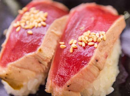 seared: Seared Tuna Sushi Extreme Close Up Stock Photo